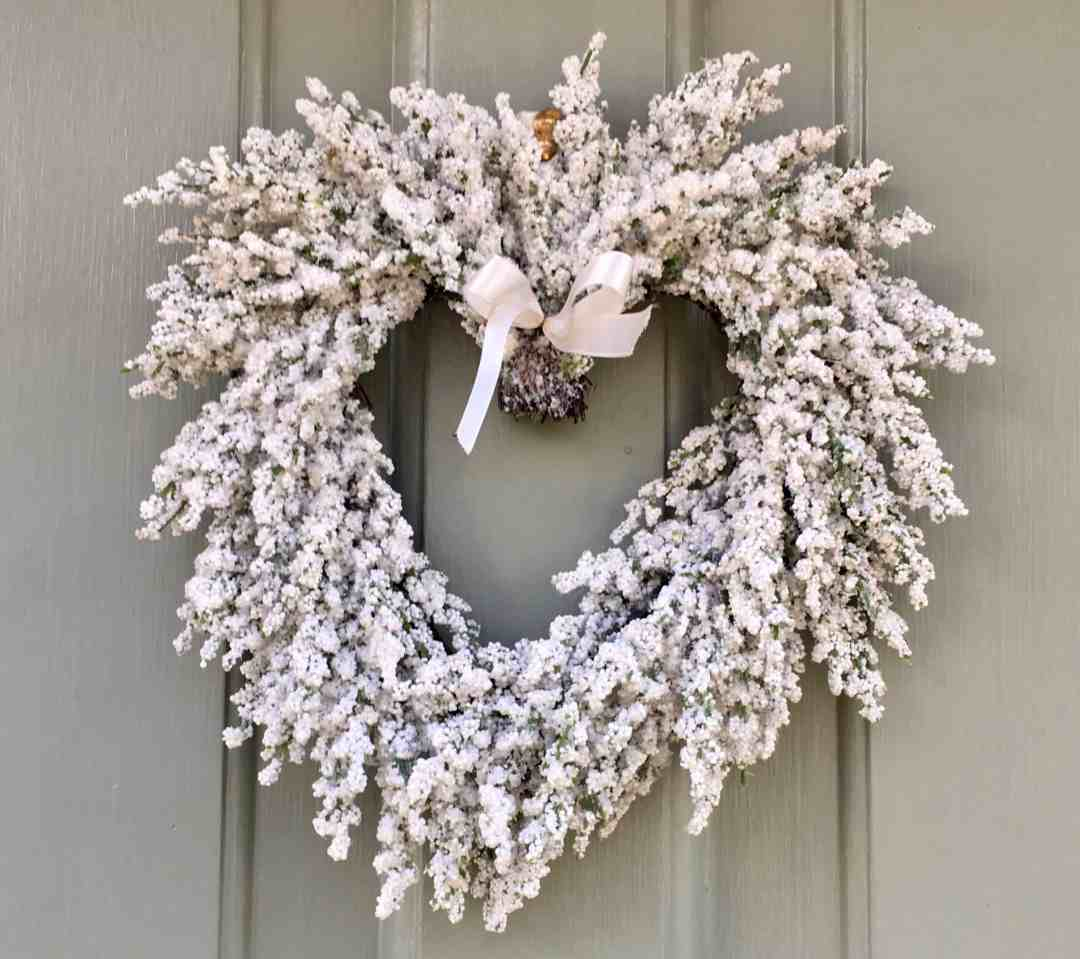 white Christmas wreath on door