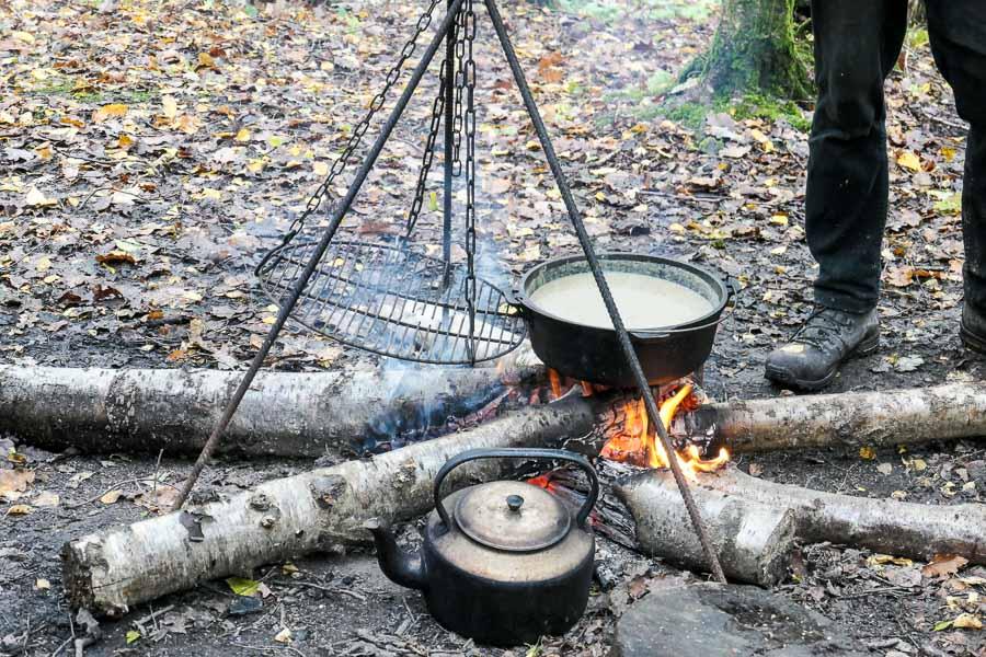 Foraged mushroom soup on campfire