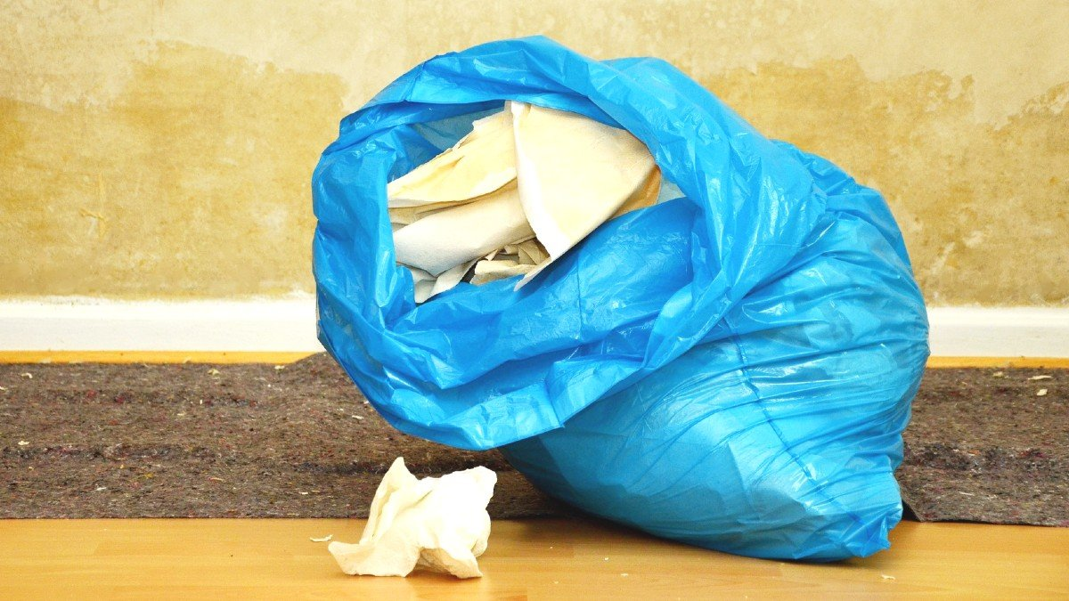 a blue garbage bag sitting on the floor