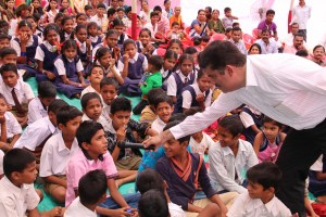 Enthusiastic students participating in a quiz competition at Karanjoti village, Thane, Mumbai