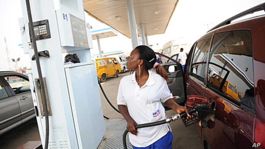 An attendant filling a customer's car with N151.6 fuel