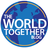 The World Together Blog logo, which is the title superimposed on a globe with a thin line outlining the globe.