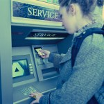 Bank - Young Woman Using ATM