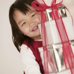 Girl Carrying Christmas Gifts