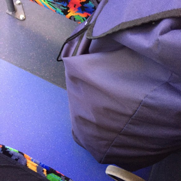 Blue shopping jeep and floor alongside multicoloured bus seat