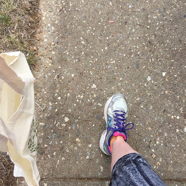 Foot & lower leg in athletic wear on path
