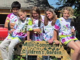 children at the Mills Community Garden