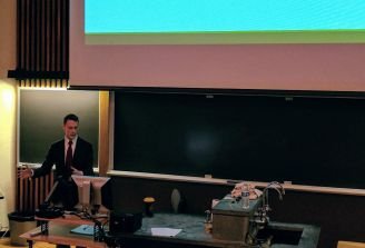 Ben Farrer presenting on his research on Green Party voting. (Image courtesy of Hannah McCullough)