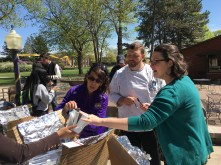The judges taking cookie samples from one of the solar ovens. (Image courtesy of Debbie Steinberg)