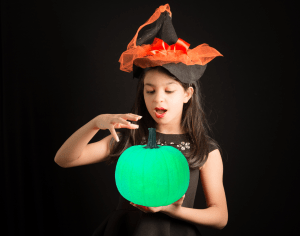 hallogreen girl holds green pumpkin