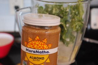 almond butter in front of smoothie
