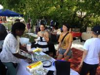 Community Organizer Sara Mokuria and trans.lation Project Manager Carol Zou visit the market and sample Susu kitchen vegan foods