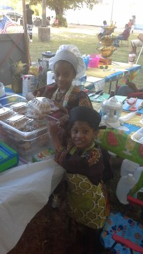 Young Entrepreneurs selling cakes and shaved ice w organic syrup