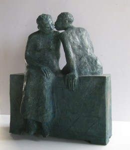 Women talking clay sculpture