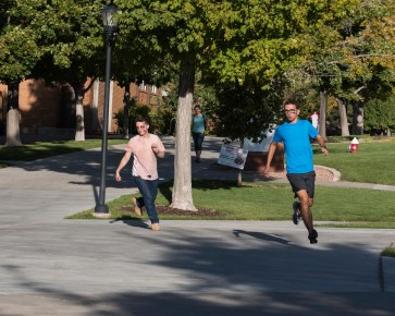 Survivor Jason Hall in full sprint as zombie Guillermo Garcia follows in pursuit. Photo courtesy of photo journalist Morgan Barton.