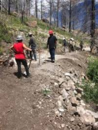 IIC interns and YCC crew build a section of trail