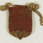 1800-1825 Brown crocheted silk bar purse.