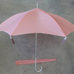 Final pagoda shape of parasol, with eight tassels. Matching sleeve is shown below.