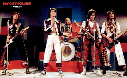 The Bay City Rollers wearing plaid everything.