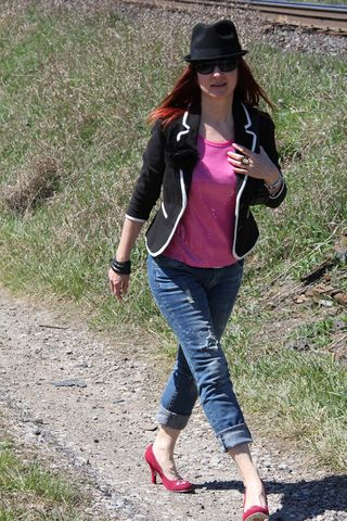 Pink sequins bowler hat walking