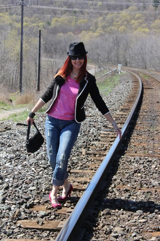 Pink sequins bowler hat rails front