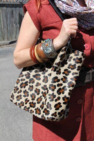 Orange jacket leggins leopard bag bangles
