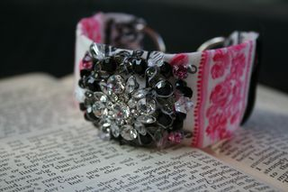 Pink black vintage cuff on book