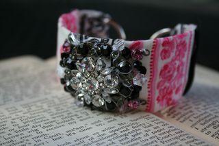 Pink black vintage cuff on book