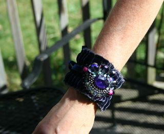 Blue velvet cuff on arm