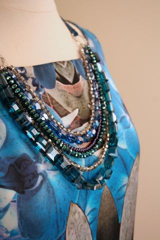 Blue dress and jewel necklace suzanne carillo