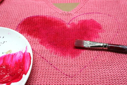 Painting heart on sweater
