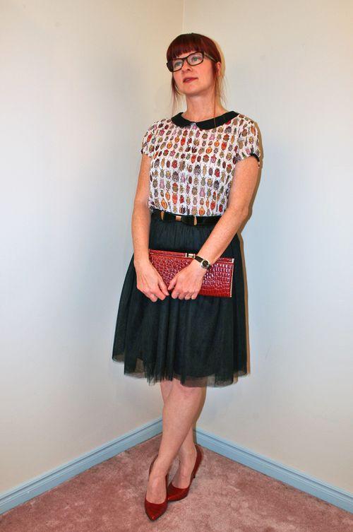 Black tulle skirt red heels bug blouse