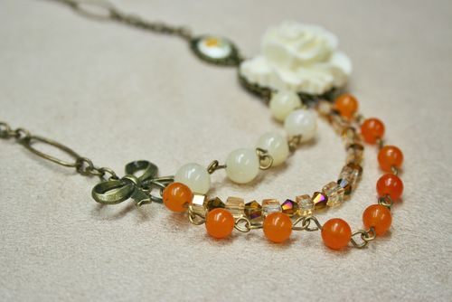 Orange white gold beaded necklace