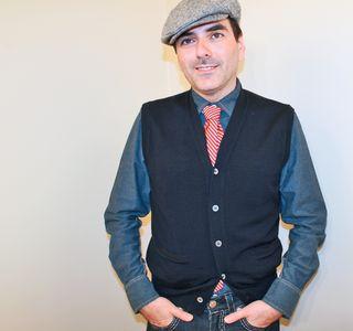 Sweater vest orange tie poor boy hat