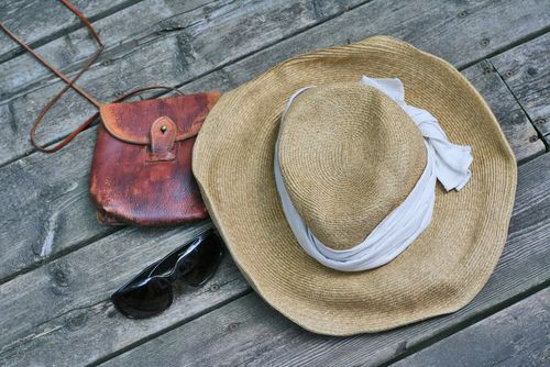 Hat sunglasses and vintage handbag