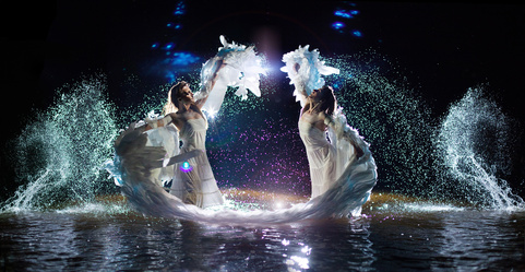 Beautiful white angels are dancing in the water drops.