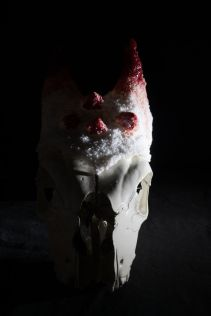 "Pate de verre crown on goat entitled ""scapegoat"""