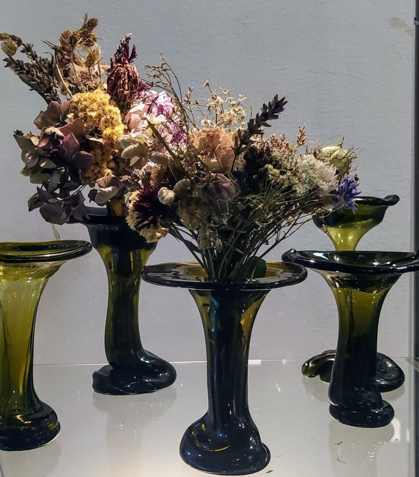 Vases with dried flowers, made from recycled wine bottle