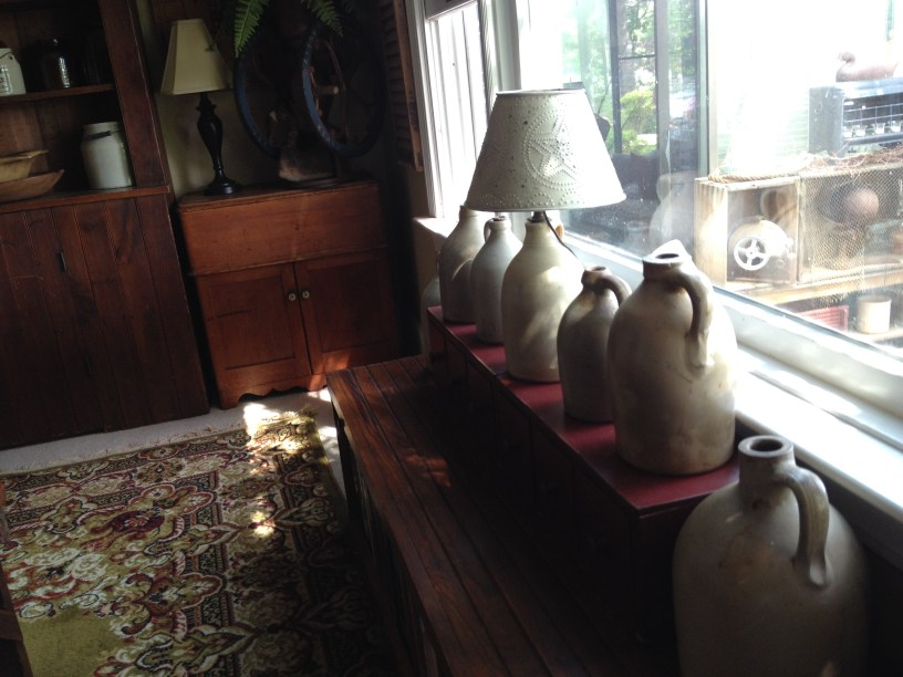 Old stoneware Jugs sit in the window