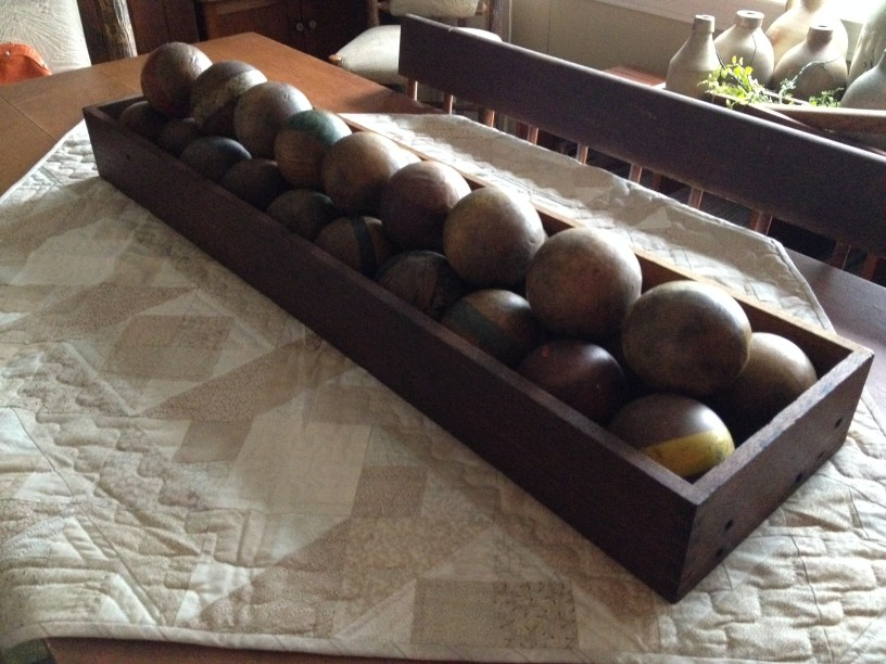 A couple dozen old wooden croquet balls add some fun to the dining room table