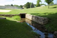 Retaining wall along stream bed