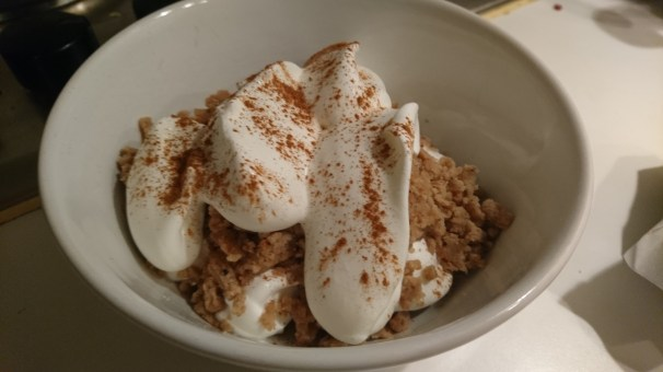 Grated sweet chestnut paste with whipped cream and cinnamon