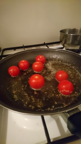 Sauteeing cherry tomatoes in an herbed white wine sauce