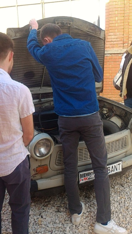 Checking in the hood of a Trabant communist car