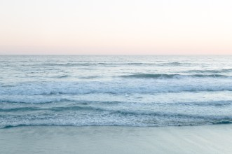 Waves roll in at Oceanside Beach, California