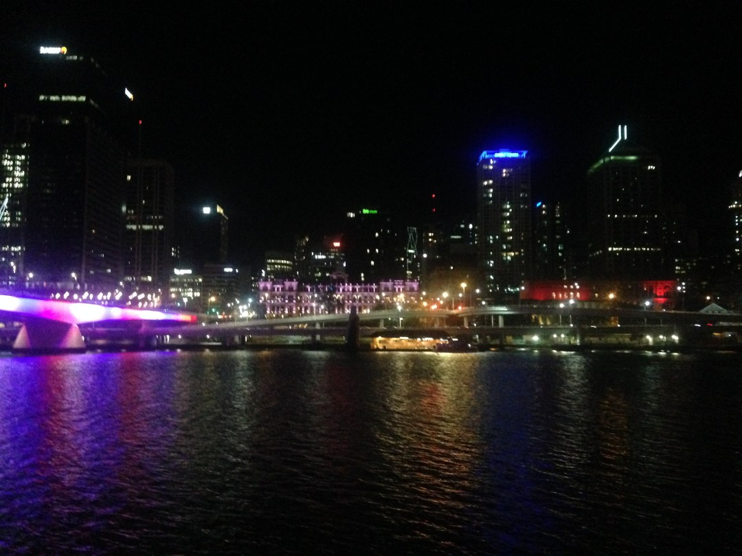 Nighttime view of the Brisbane CBD overlooking a river