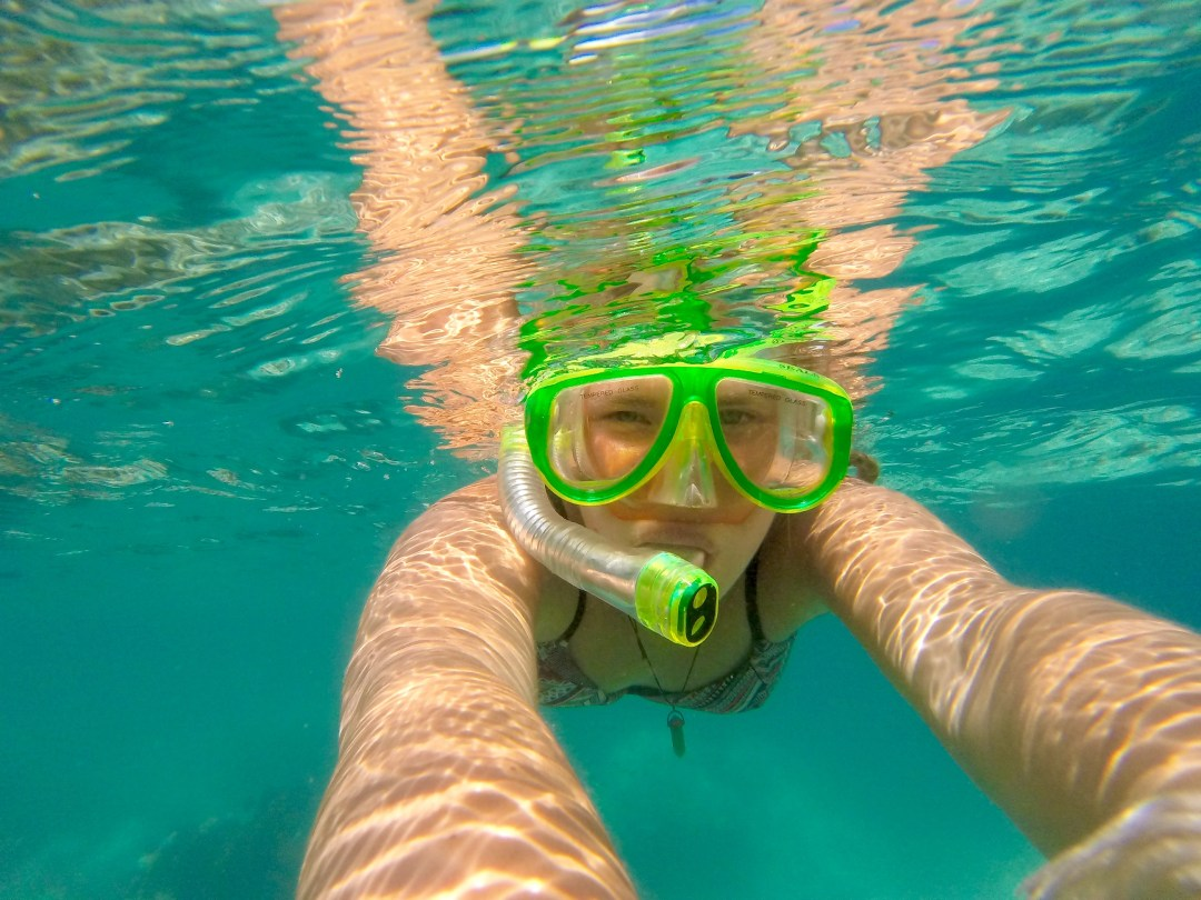Perfect clear waters as a girl snorkels in Cambodia