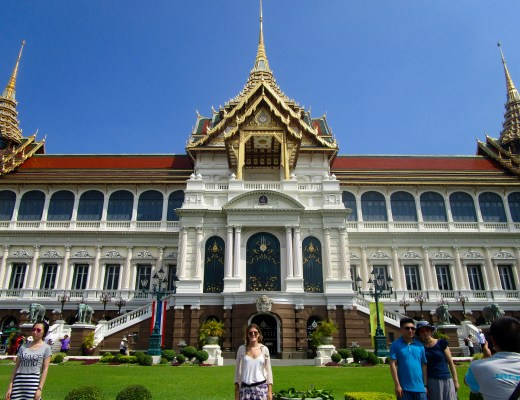 Posing in front of the Grand Palace building among other tourists