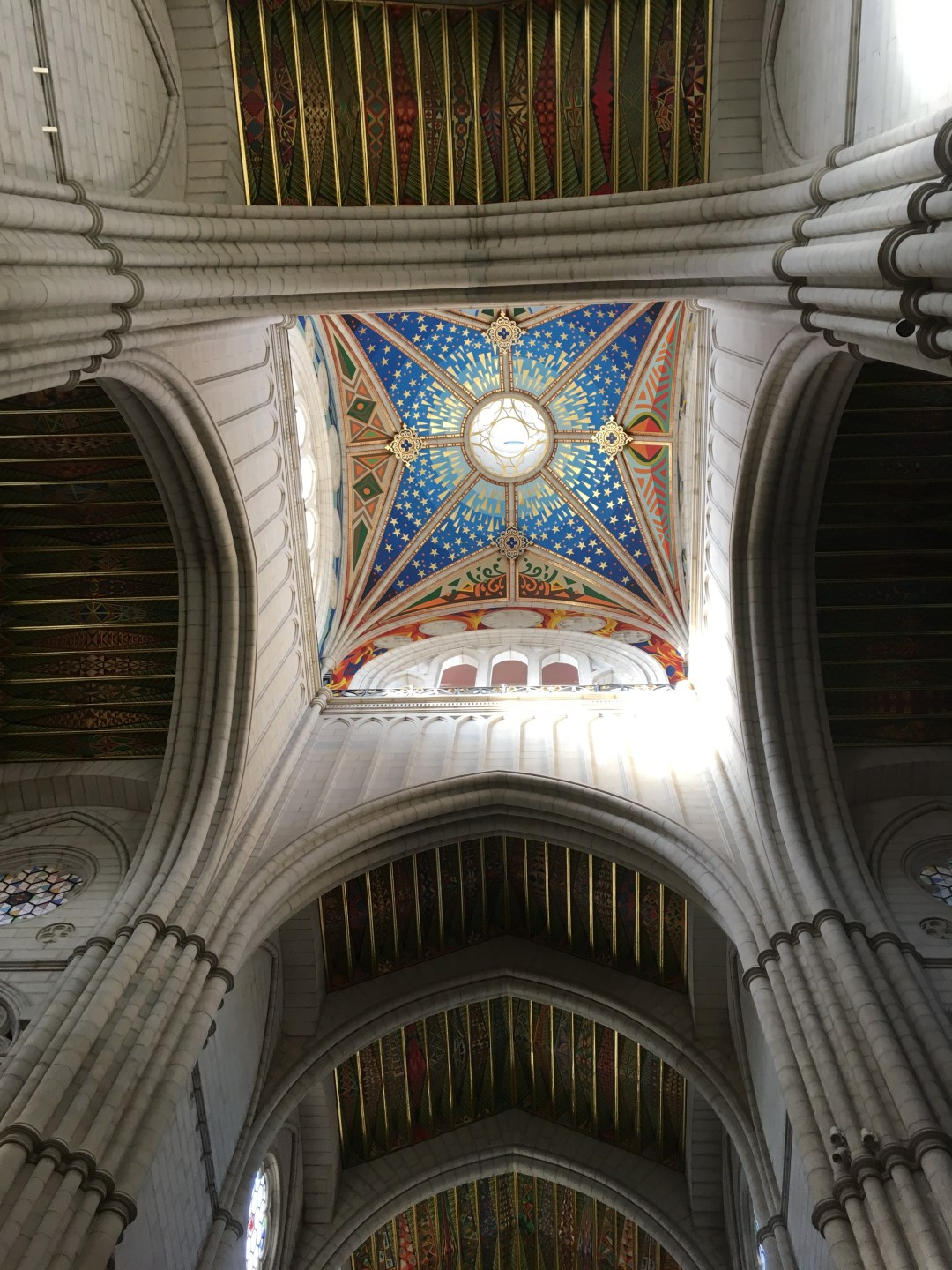 The brightly coloured ceiling design of Madrid's cathedral