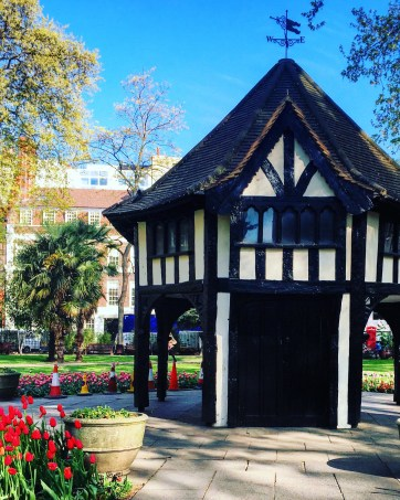 Old building in the centre of Soho Square on a sunny day